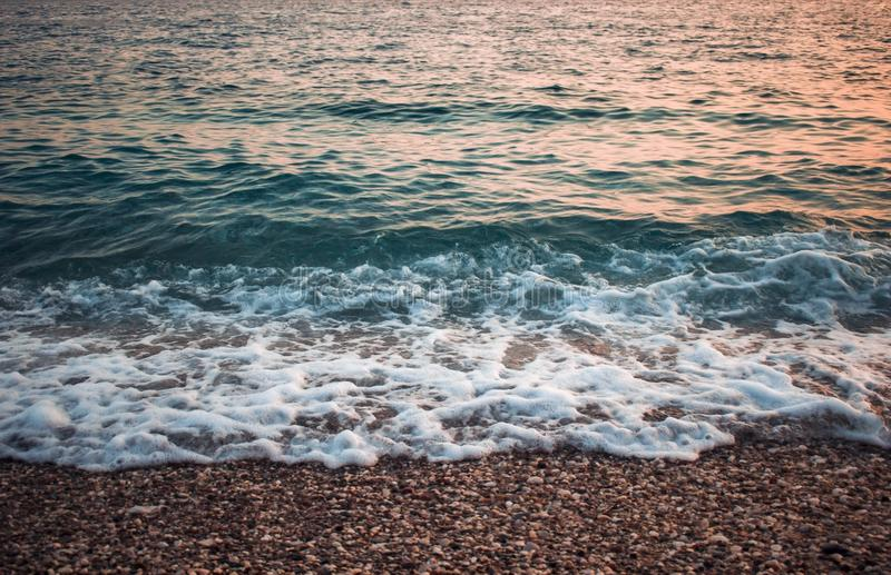 Sea coast with waves at the sunset - Adriatic sea royalty free stock photography
