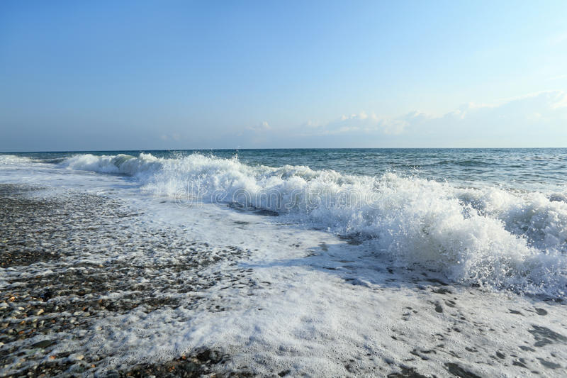 Sea coast with waves, wide angle. Summer stock photo