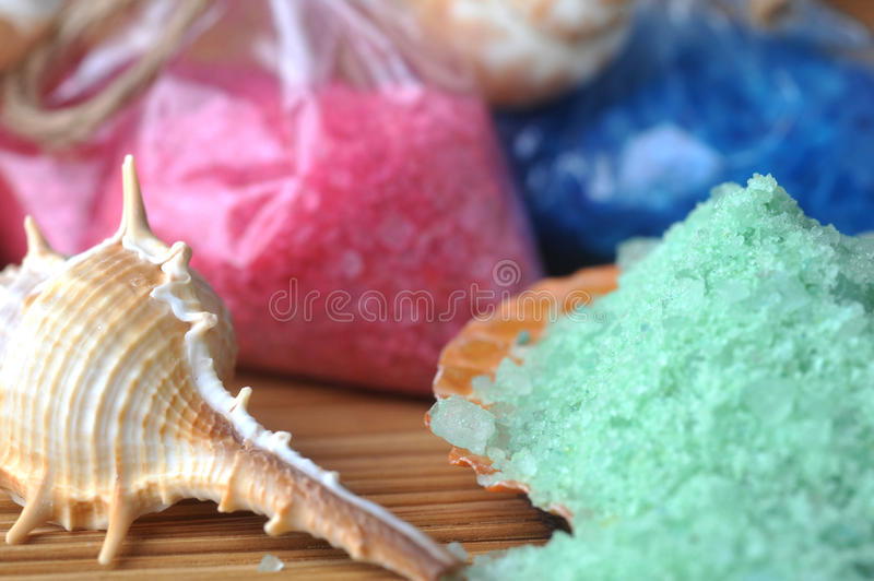 Sea cockleshells and salt. For bath on straw napkin stock images