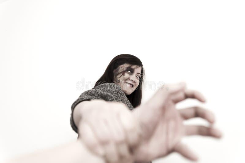 Sea cogido por la muchacha del zombi foto de archivo libre de regalías