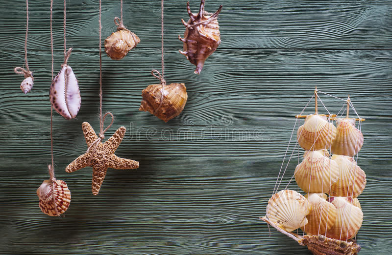 Sea composition with ship, seashells, copy space on wooden background. royalty free stock images