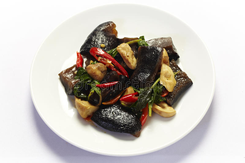 Sea cucumber stir fried with spicy sauce stock photo