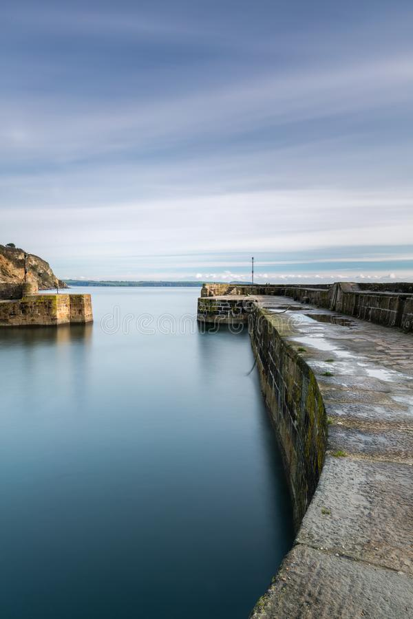 Sea Defence, Charlestown Harbour, Cornwall. Sea Defence with tranquil and serene sea at the historic Charlestown Harbour, south Cornwall stock photos