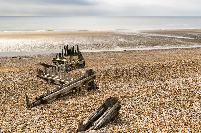 Sea defences at Rye Bay. Old broken sea defences at Rye Bay on the south coast of East Sussex, England. 30 August 2018 royalty free stock image