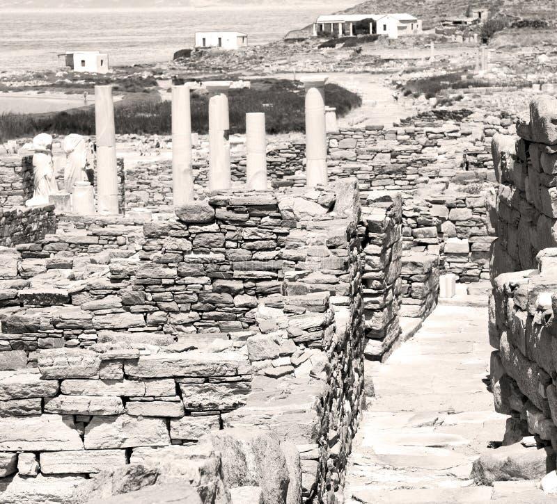 Sea in delos greece the historycal acropolis and old ruin site. In delos greece the historycal acropolis and old ruin site stock images