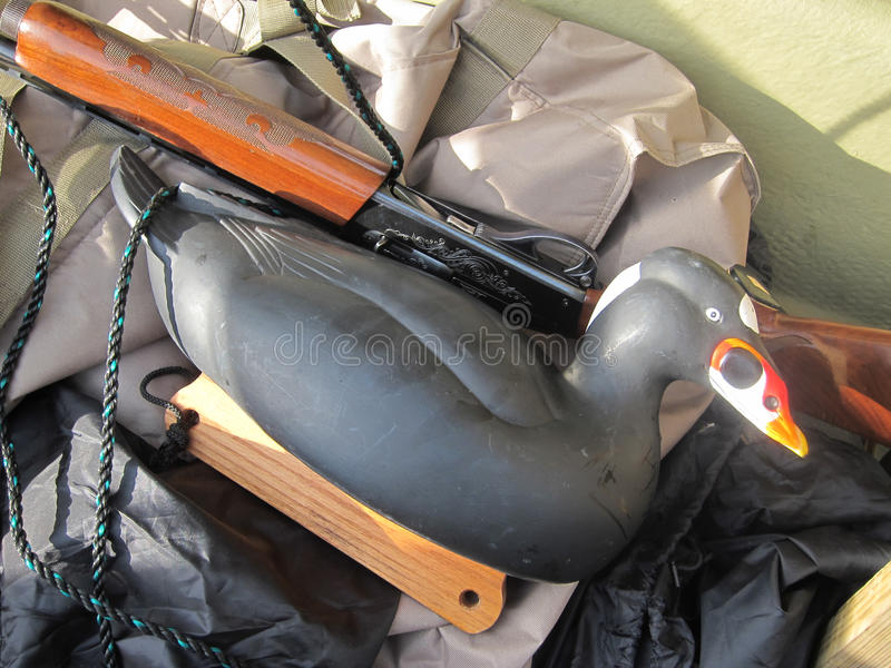 Sea duck decoy. Sea duck hunting with shotgun and decoy in boat royalty free stock photos