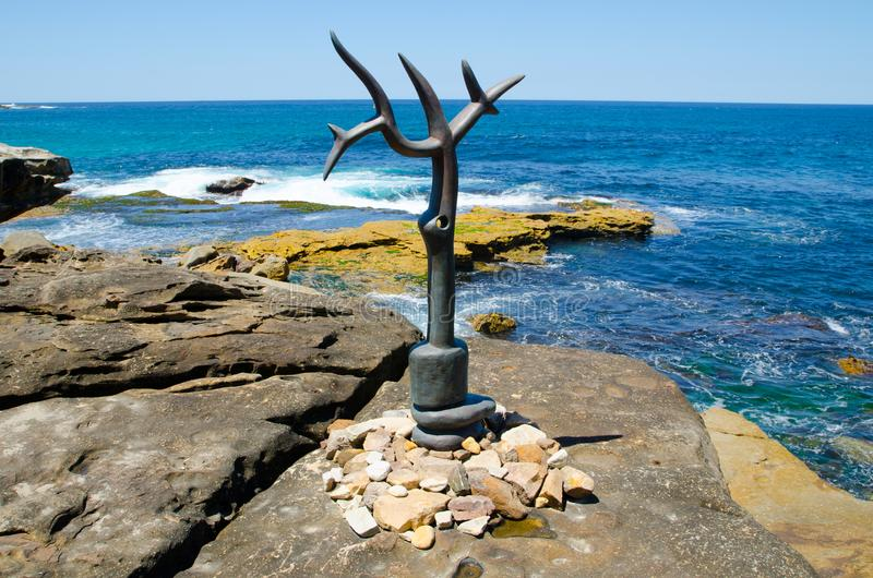 ` Sea Eagle Glyph ` is a sculptural artwork by G.W. Bot at the Sculpture by the Sea annual events free to the public sculpture. SYDNEY, AUSTRALIA. – On stock photo