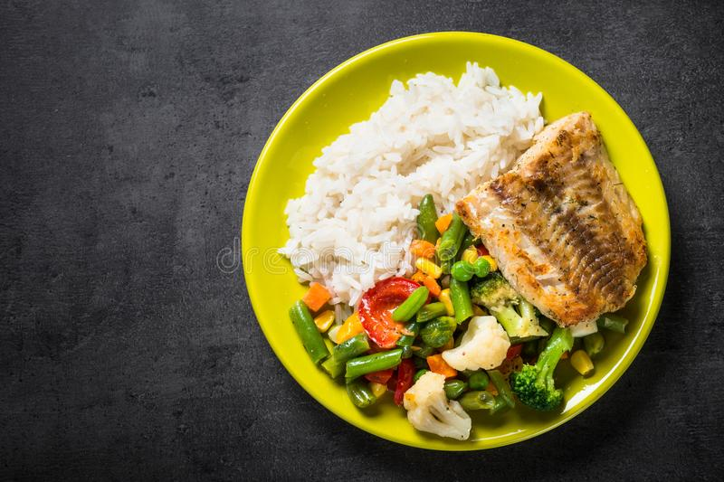 Sea fish, rise and vegetables. stock photos