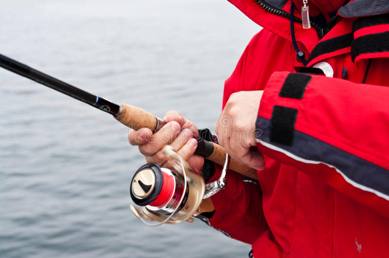Sea fisherman in red stock image