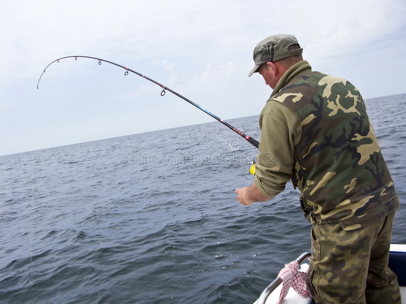 Sea fishing from boat stock photo