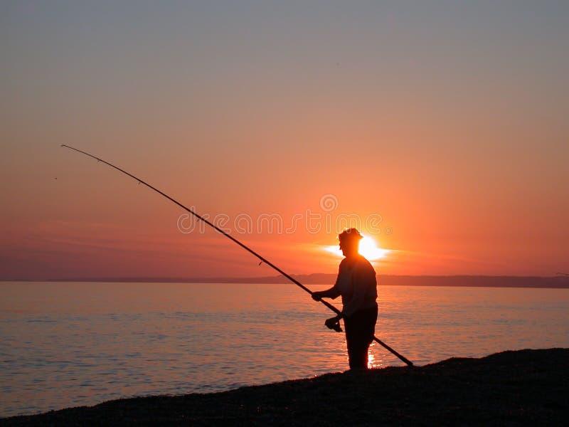Sea fishing at dusk royalty free stock images