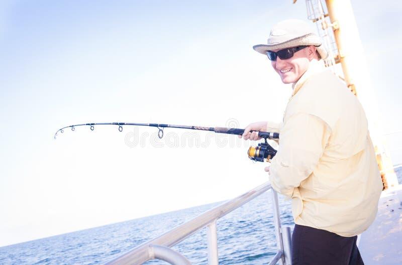 Sea Fishing- Happy Man stock photos