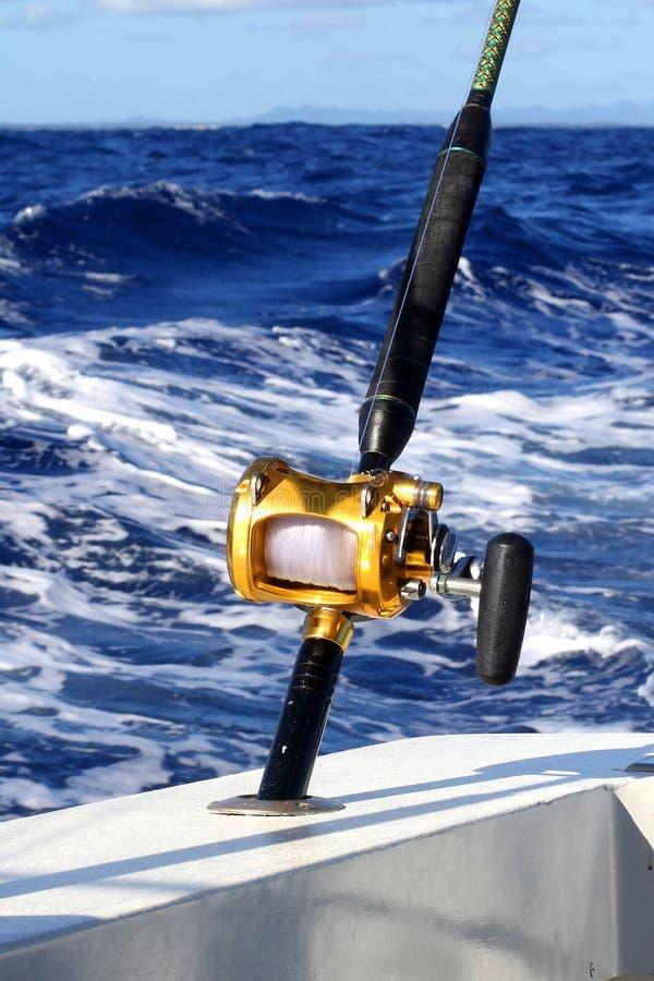 Sea fishing reel. Beautiful Atlantic Ocean. Yacht. stock photos