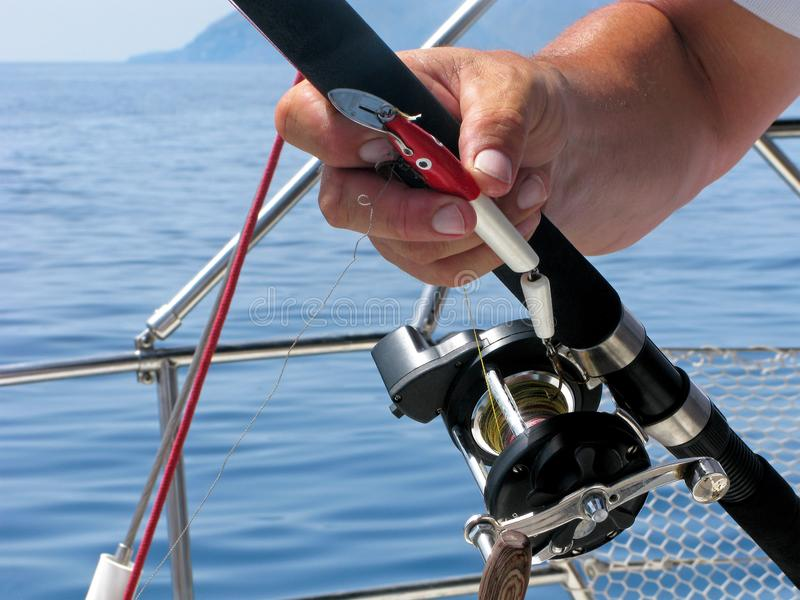 Sea fishing, spinning reel and fishing hook close-up stock photography