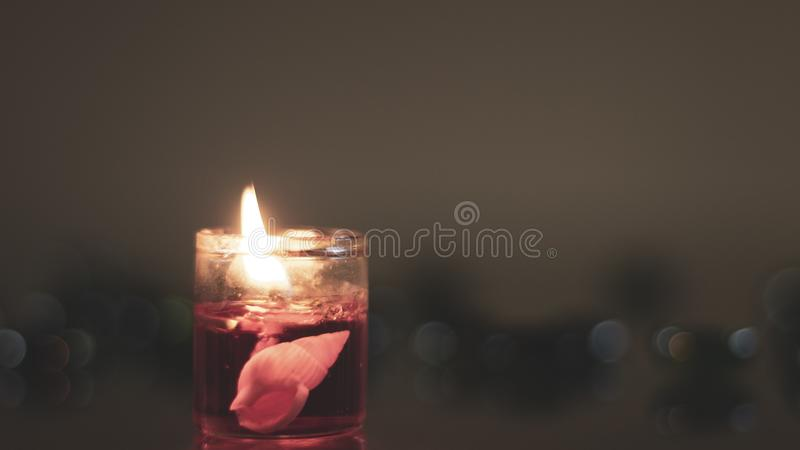 Marine objects inside a candle. Warmth and delicacy in a glowing adornment. royalty free stock image