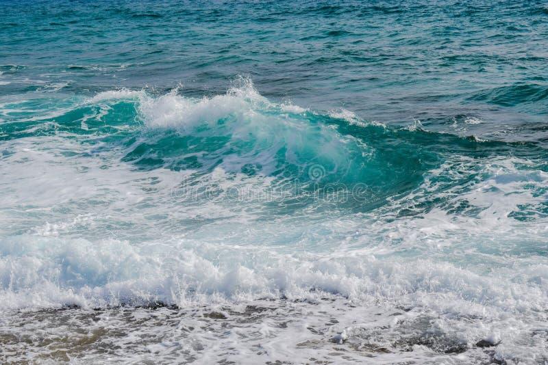 Sea foam and waves on beach stock photos