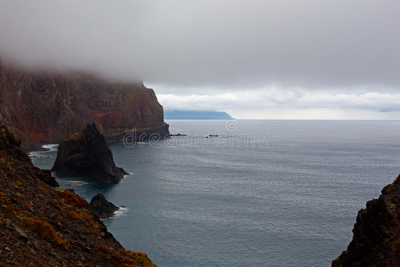 Sea fog and cliffs of the island  Madeira