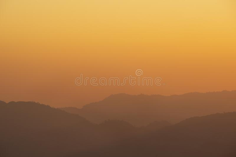 Sea of fog and mountain silhouette during sunrise in the morning at Doi Luang Chiang Dao royalty free stock image