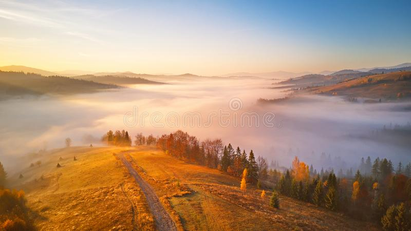 Sea of fog in mountain valley. Awesome alpine highlands royalty free stock photos