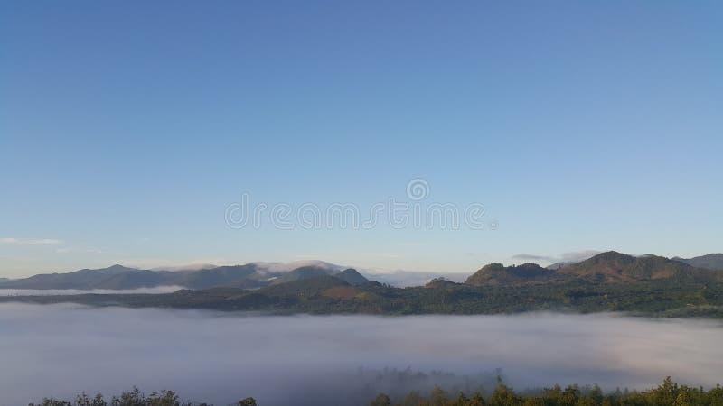 Sea of fog over mountains stock photo