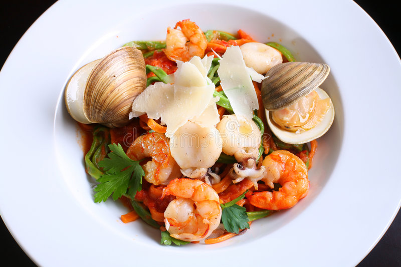 Sea food. Shellfishes and shrimps on a white dish stock image