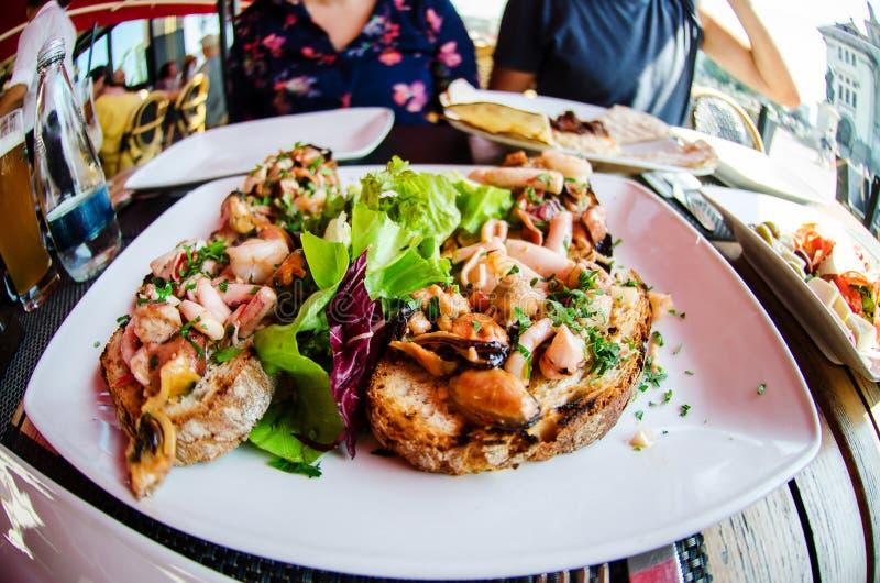 Sea food bruschettas stock photos
