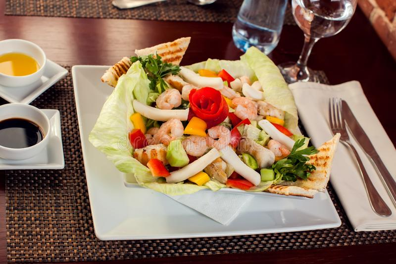 Sea food salad with sauces on white plate. Food and restaurant concept stock image
