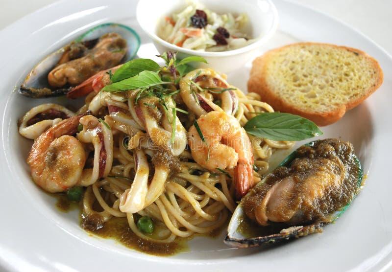 Sea food spaghetti green curry sauce royalty free stock image