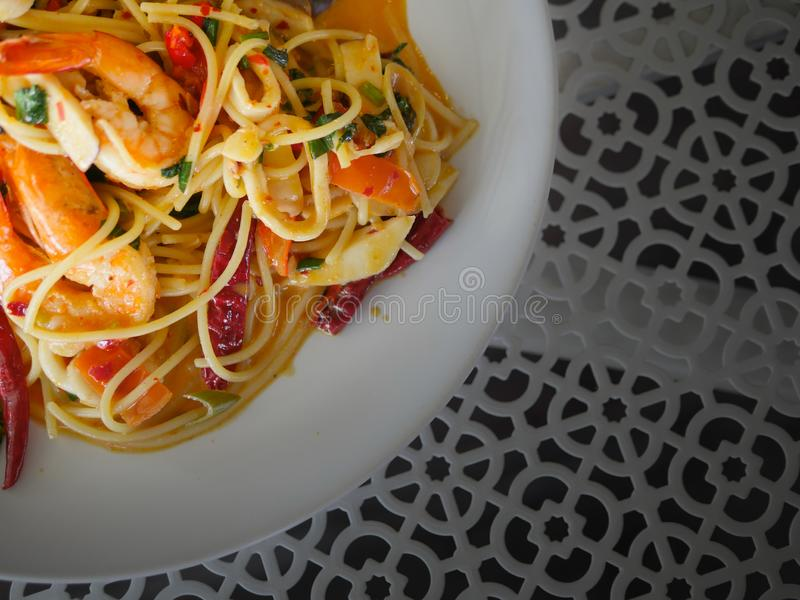 Spaghetti with Thai style sea food royalty free stock photography