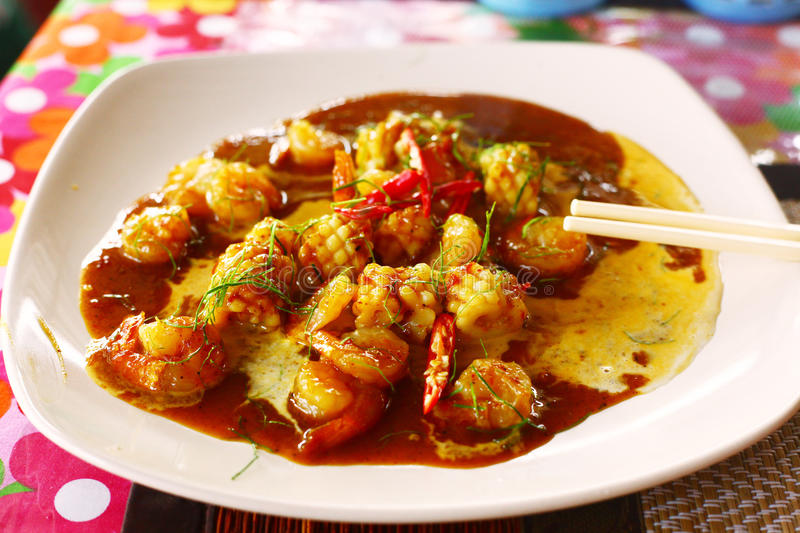 Sea food in spicy curry sauce and coconut cream stock photography