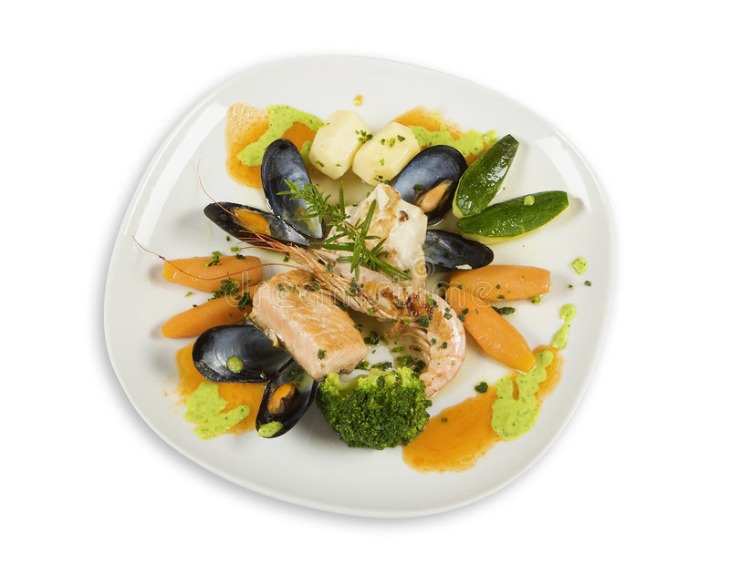 Sea food and vegetables on plate stock image