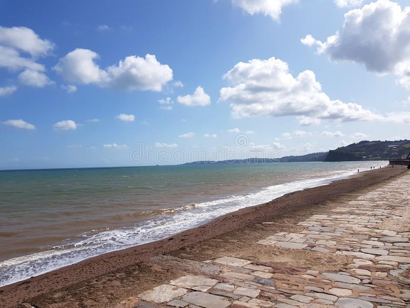 Sea front in Dawlish, United Kingdom. Sea front in , united kingdom. beach, tree, dune, coast, poland, water, , summer, cornwall, clouds, sun, seascape stock photo
