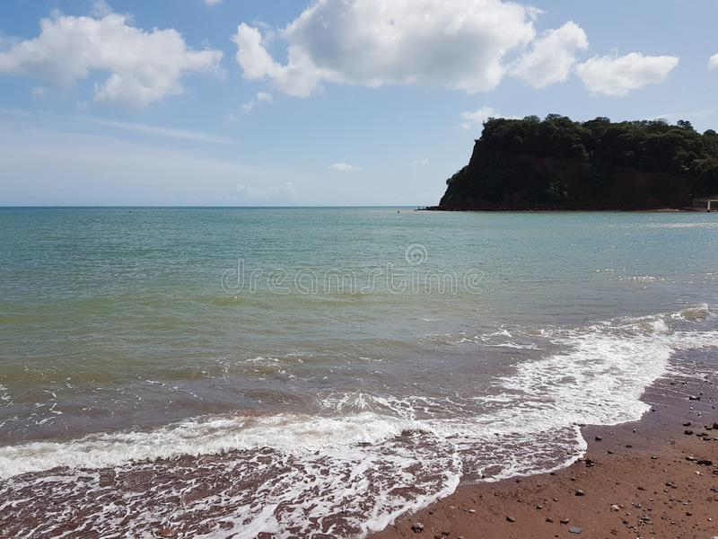 Sea front in Teignmouth, United Kingdom. Sea front in , united kingdom. beach, tree, dune, coast, poland, water, summee, summer, cornwall, clouds, sun stock images