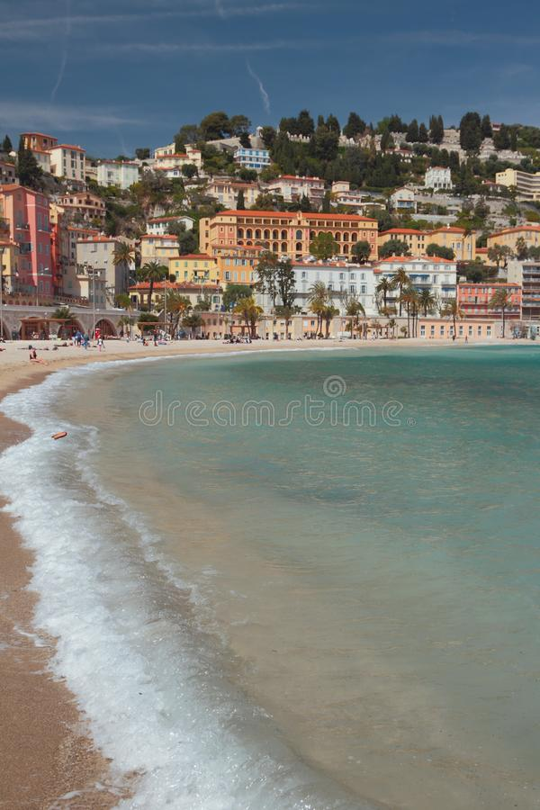 Sea gulf and city on hill. Menton, Nice, France. 2019-04-20 royalty free stock photos