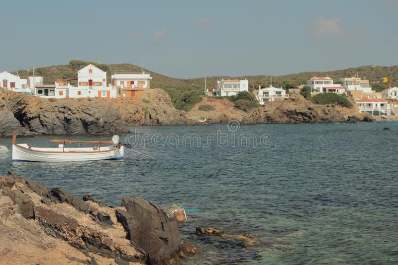 Sea gulf and fishing village on rocky coast. Cala Mesquida, Menorca, Spain stock photography