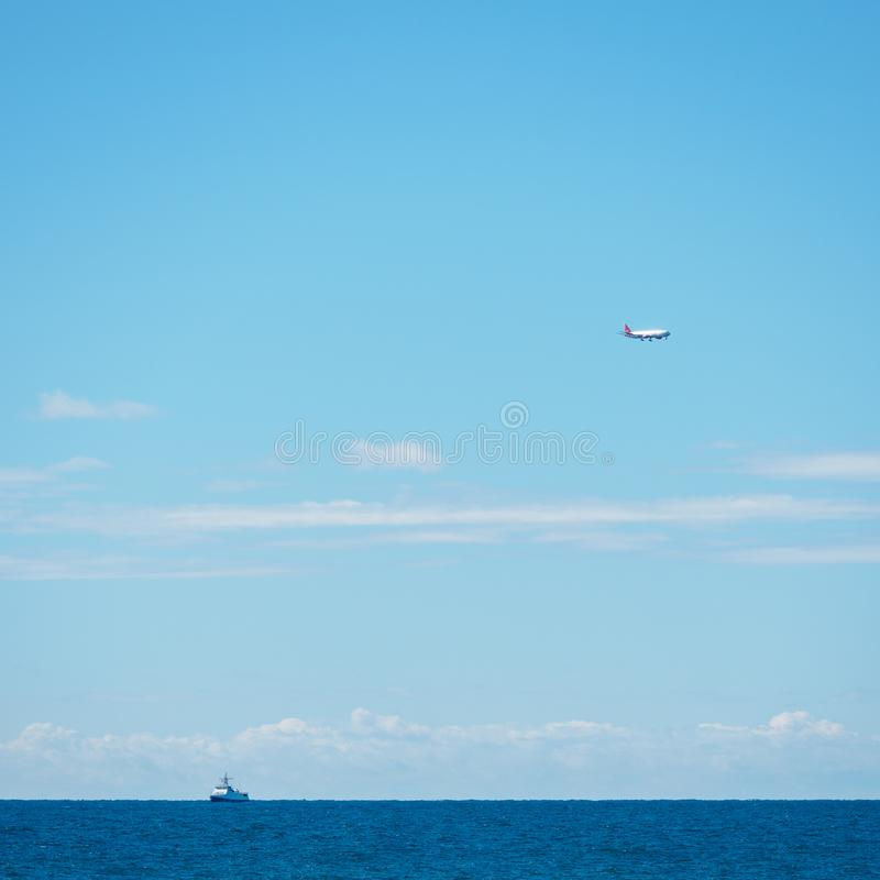 Sea horizon and clear blue sky. Ship and plane on the horizon stock photos