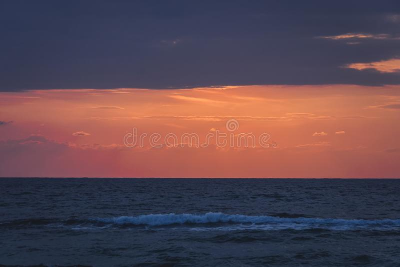 Sea at Huahin. Horizon line of the sea. tinted retro photo. Beautiful cloudy sky at dawn. Three lines of different colors created by nature. calm the sea after stock photo