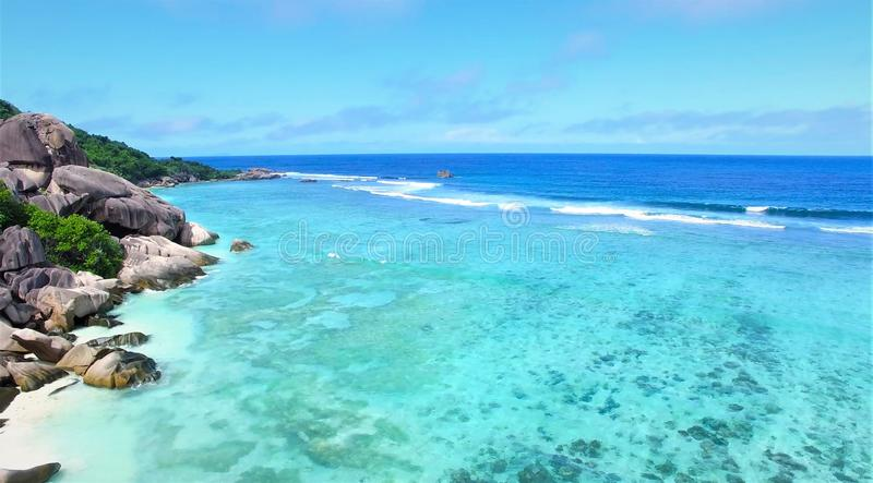 Top view aerial photo from flying drone of Indian Ocean seashore with beautiful color sea waves. Wonderful seascape with copy spac royalty free stock images
