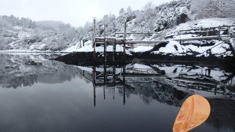 Sea kayaking in Norway - Ostereidet gulf royalty free stock photography
