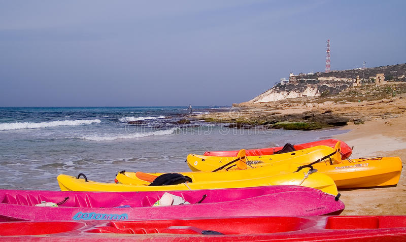 Sea kayaks at the beach ready for fun stock images