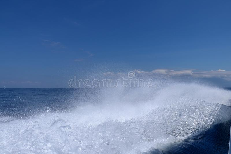 Sea and kielwater seen from ship, trail on the water after the ferry sail, wake of speed boat. Wake caused by cruise ship. Sea wat. Er foam Ship track in the stock images