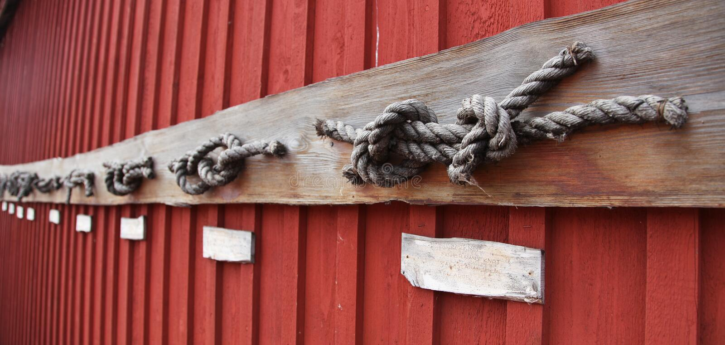 Sea knots on a red barn in Marienhamn. Sea knots on a red barn in shipyard in Marienhamn on Aland islands stock photo