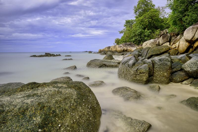 By the sea at Koh Lipe, Satun, Thailand. In the morning, photographing the rocks in the sea Long-exposure photography. Makes the sea beautiful stock image