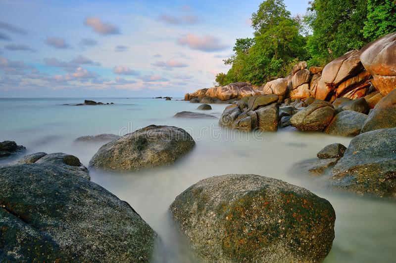 By the sea at Koh Lipe, Satun, Thailand. In the morning, photographing the rocks in the sea Long-exposure photography. Makes the sea beautiful royalty free stock photo