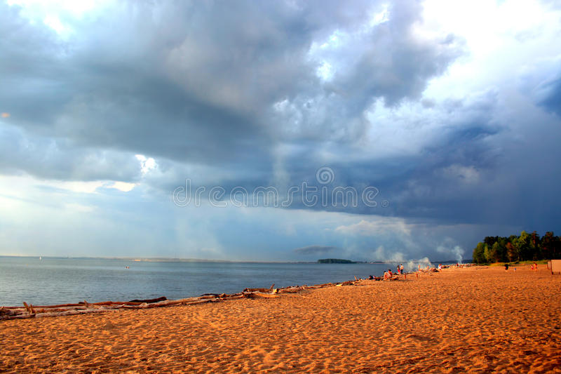 Sea landscape. Empty evening beach with dramatic sky stock photos