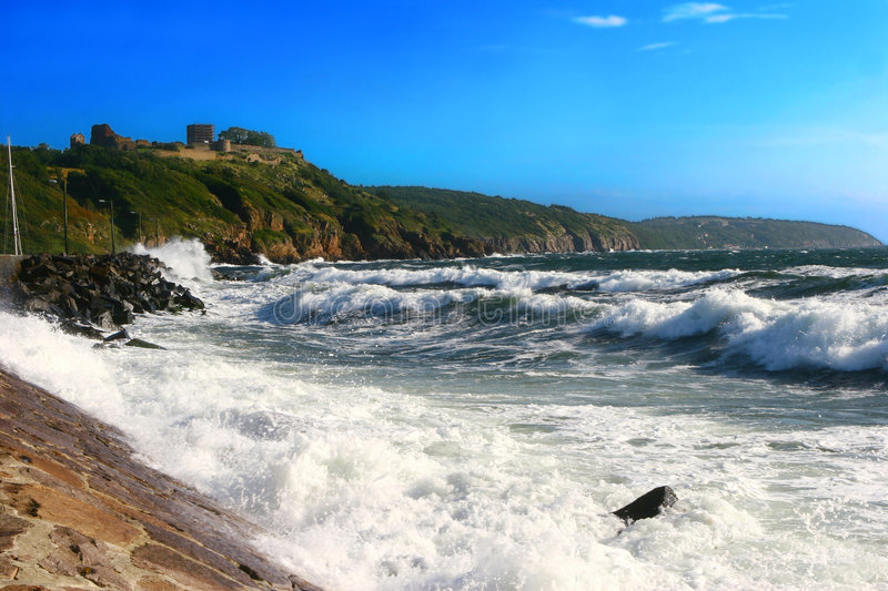 Sea landscape. With castel on rocky granite coast royalty free stock image