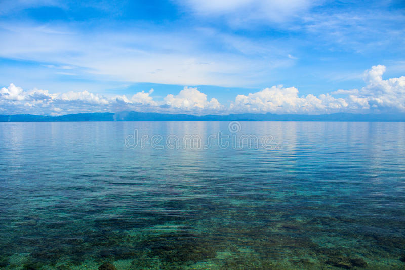 Sea landscape with clouds. Peaceful blue seascape. Tropical seaside minimal photo for wedding background. royalty free stock photos