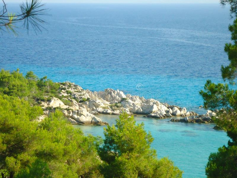 Sea landscape in Greece with green trees and blue sea royalty free stock photos