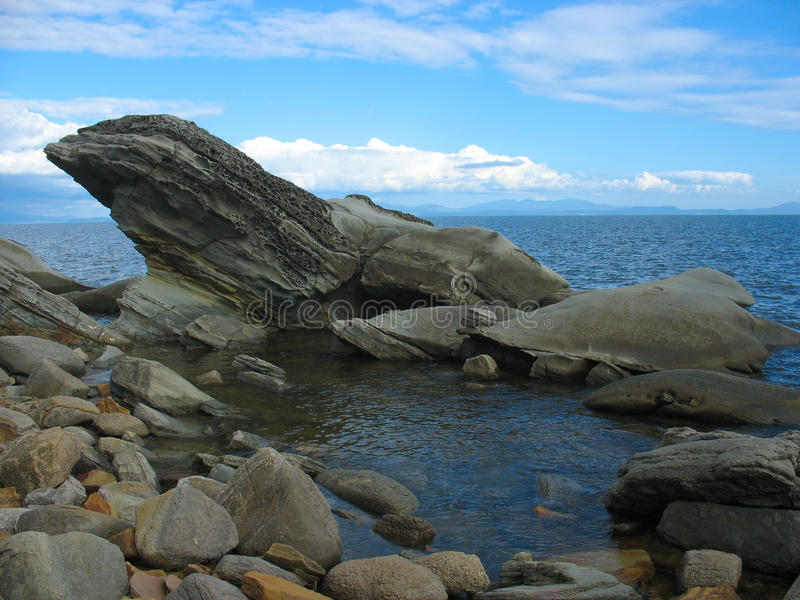 Sea landscape with intricate stones (boulders) royalty free stock images