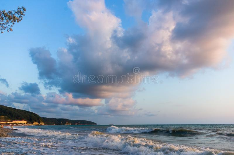 sea landscape is a pebbly beach with waves in white foam stock images
